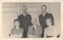 October 1945, Otto Frank seated in the middle with Miep Gies and Johannes Kleiman on the left, and Bep Voskuijl and Victor Kugler on the right.