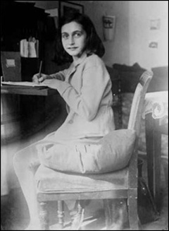 Anne Frank writing at her desk at home at the Merwedeplein, 1941