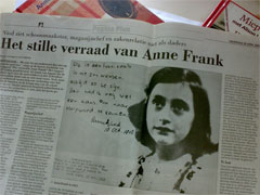 "Headline ""The silent betrayal of Anne Frank"" in Dutch newspaper after the NIOD report was published, April 28, 2003."